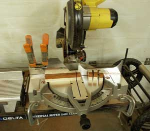 Checkerboard layers being cut on teh mitre saw.